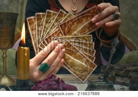Tarot cards on fortune teller desk table. Future reading.