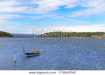 Lake with fishermans boat near Village Gruissan in French languedoc-Roussillon