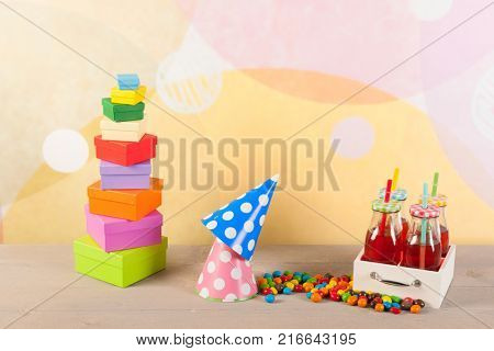 Colorful sweets and little bottles lemonade with drinking straws for the child party