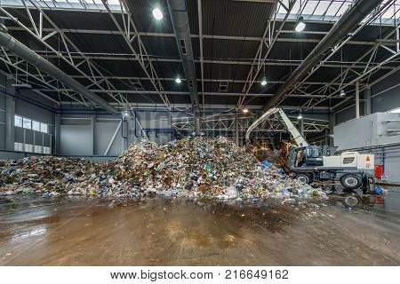 Plastic bales at the waste processing plant. Separate garbage collection. Recycling and storage of waste for further disposal. Business for sorting and processing of waste.