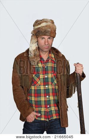 Man wearing fur hat and suede Indian jacket