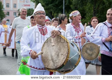 Yoshkar-Ola, Russia - June 25, 2016 A cheerful man in the national costume of Mari at the Peledysh Payrem Festival in Yoshkar-Ola, Russia