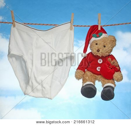 happy Merry X mas  Hanging male pants and doll.