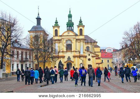 Ivano-Frankivsk / Ukraine - 29 October 2017 / Ukraine: Ivano-Frankivsk city views: walking area with a view of the Church of Vir gin Mary. 29 October 2017 Ivano-Frankivsk, Ukraine.