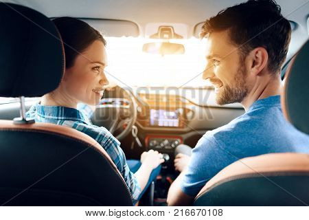 In the car, her family also sits. They came to the car showroom to buy a new car. They are very happy about this, they are in a good mood.