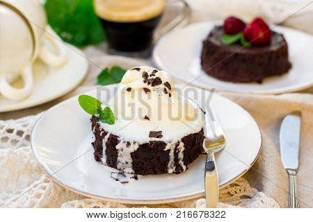 Molten chocolate cake fondant with vanilla ice cream and strawberry for dessert