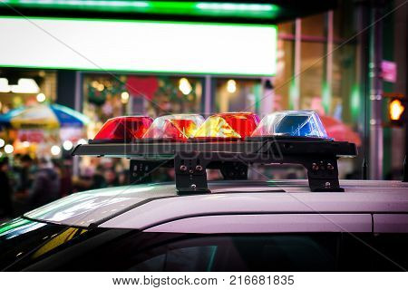 Police car with emergency lights red and blue