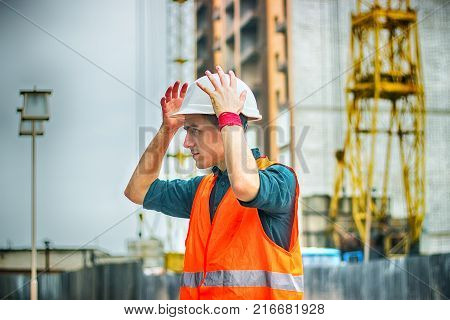 Engineer or Architect checking a personal protective equipment safety helmet at construction site. Engineering Architecture and building construction concepts