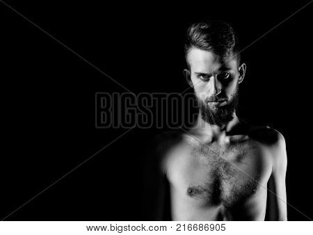 handsome bearded man or hipster guy dieting with serious face and bare slim or thin body chest and torso with anorexia isolated on black background copy space