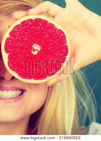 Girl Covering Her Eyes With Lemon Citrus Fruit