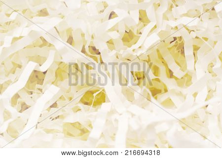 Paper strips filler for gift wrapping. Holiday celebratiion background. Present texture
