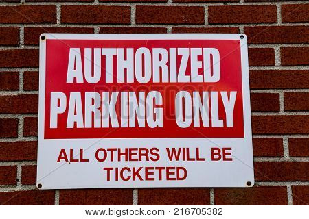 The Authorized Parking Only wall sign sign.
