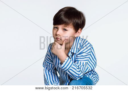 Studio portrait of a boy with serious worries