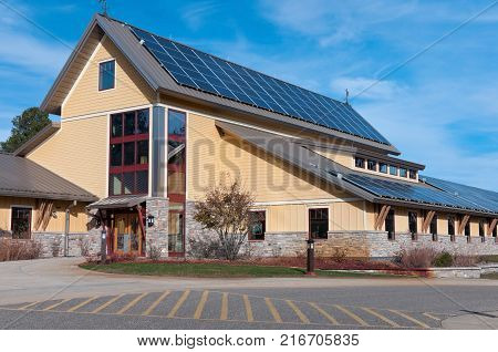 wildlife refuge visitor center at front entrance and rooftop solar panels in juneau county wisconsin