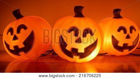 Smiling glowing pumpkins for the Halloween season.