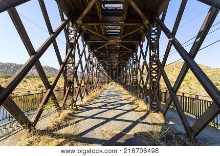 The abandoned road inside the truss bridge crossing the Douro River in Pocinho Douro region Portugal