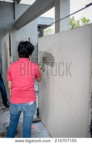 in house training cement plastering construction by use skim coat