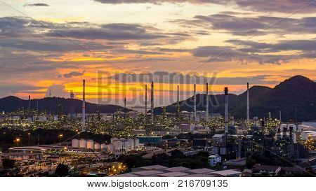 Beautiful sunset petrochemical oil refinery factory plant cityscape of Chonburi province at night landscape Thailand