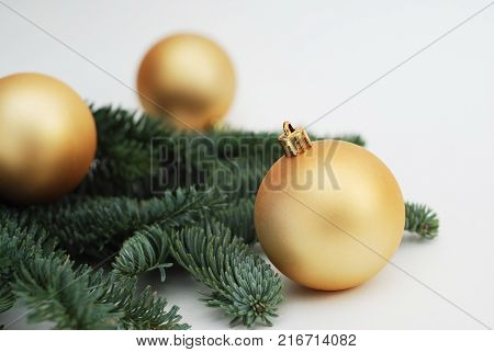 Christmas Background with Copy Space. Golden Cristmas Tree Bals or Globes with Fir Branches
