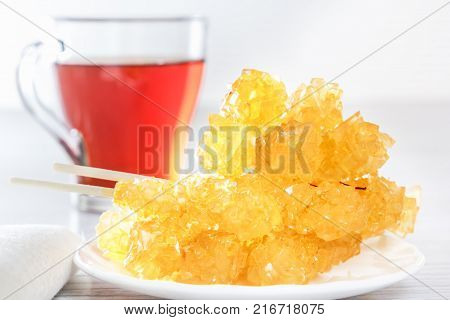 Traditional oriental sweets nabat - crystallized sugar with tea. Middle Eastern and Asian dessert