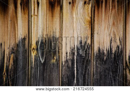 Old Boards With Darkened Textured Wood Background With Part Of Blue Window