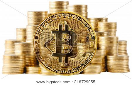 Gold bitcoin on a background of rising columns of coins isolated on a white background. The concept of bitcoin growth and replacement of real money with virtual ones.