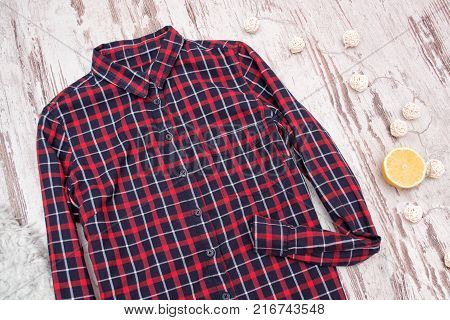 Checkered Shirt On A Wooden Background. Fashionable Concept