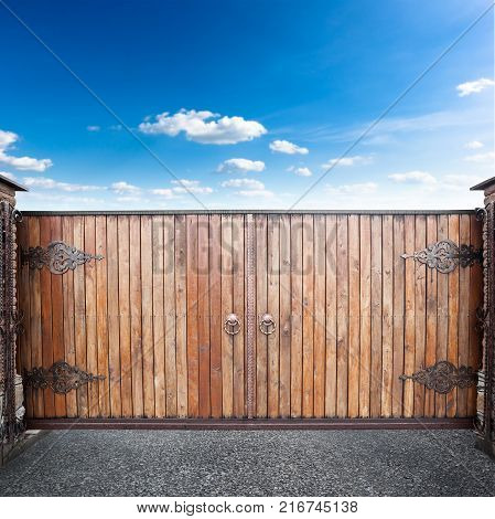 Closed wooden gates is over sky background