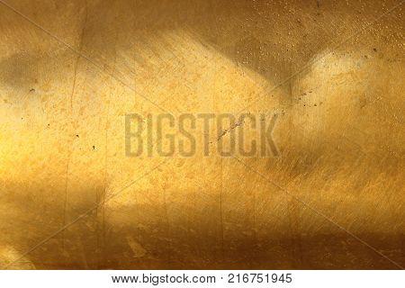 The dark golden brass texture for background