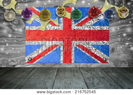 Christmas background with christmas ball and british Flag on a old wooden background