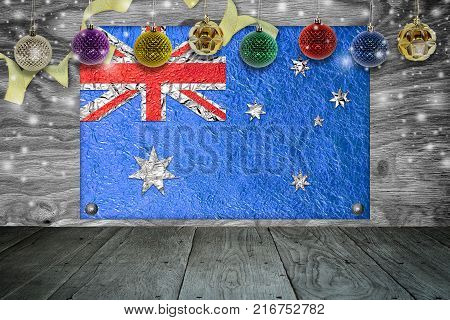 Christmas background with christmas ball and australia Flag on a old wooden background