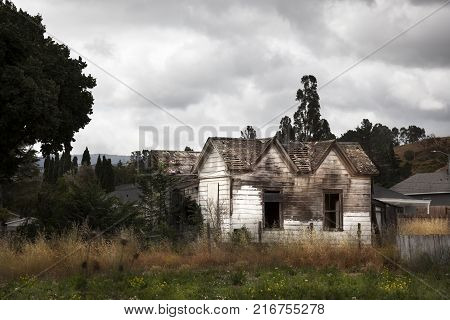 Old wood house on Real way. California