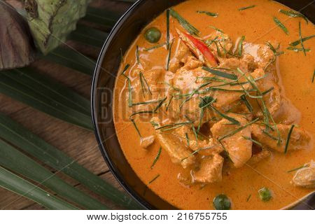 Thai curry red soupThailand tradition red curry with beefpork or chicken menu in thai name is panaeng.Curry menu with coconut milk.Panaeng Curry on Wooden table