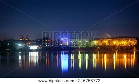 Panorama night city lights. Colourfull reflection in water