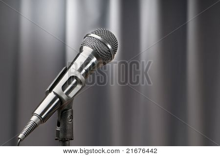 Audio microphone against the background poster