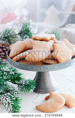 Pepparkakor or traditional Christmas Swedish cookies on a metal stand, selective focus