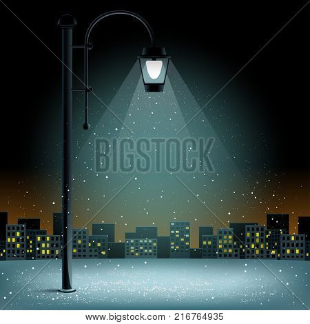 Snow in electric lamp lights. Christmas snowflakes falls on night city silhouette background. Large electric pillar