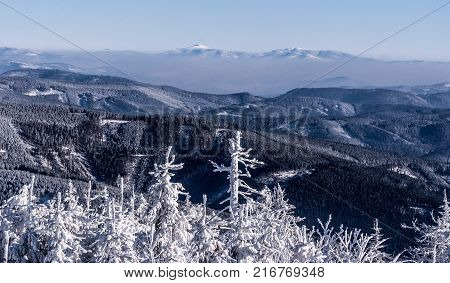 view to Babia Gora Pilsko and other hills of Beskids mountains from Lysa hora hill in Moravskoslezske Beskydy mountains in Czech republic during nice winter day