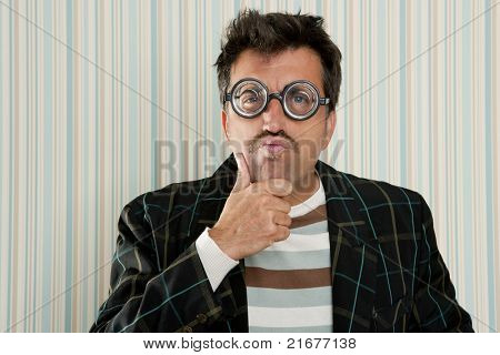 nerd silly myopic man with glasses thinking doing funny gesture with retro mustache