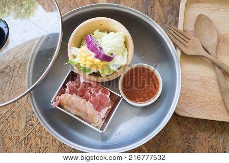 Shabu Shabu or Sukiyaki is a Japanese style and Korean style (served in pot)