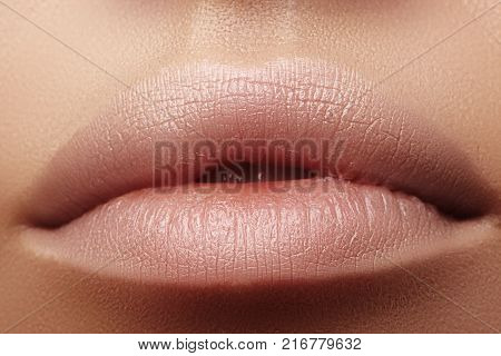 Moisturizing lip balm lipstick. Close-up of a beautiful sexy lips. Nice full lips with lip makeup. Filler Injections Plastic Surgery Collagen and Treatments