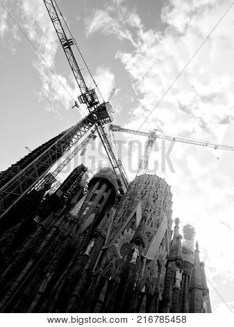 BARCELONA, SPAIN - AUG 30th, 2017: View of main facade of Sagrada Familia Holy Family church designed by Spanish architect Antoni Gaudi.