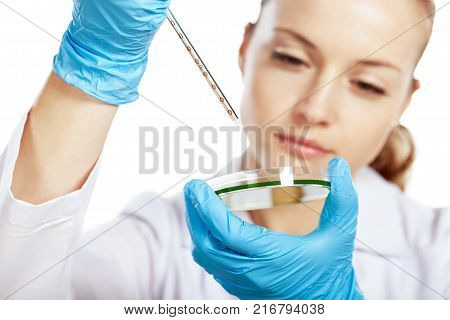 Female young biologist blue background view glass