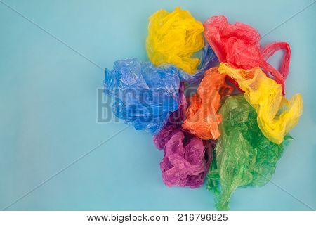 Different plastic bags on blue background. Top view.