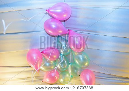 Balls gel multi color close. Background of festive balloons inflated.