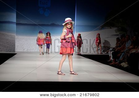 VALENCIA, SPAIN - JULY 1: An unidentified child model on the runway at the FIMI Children's Summer Fashion Show for designer Tuc-Tuc in the Feria Valencia on July 1, 2011 in Valencia, Spain.