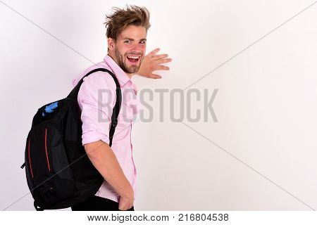 Guy In Pink Shirt With Rucksack On Shoulder. Education Concept