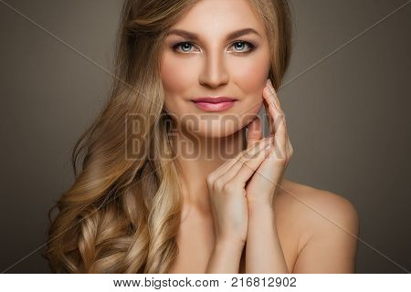 Beautiful Woman with Long Blonde Hair and Fresh Skin touching her Hand Her Face Female Face Closeup