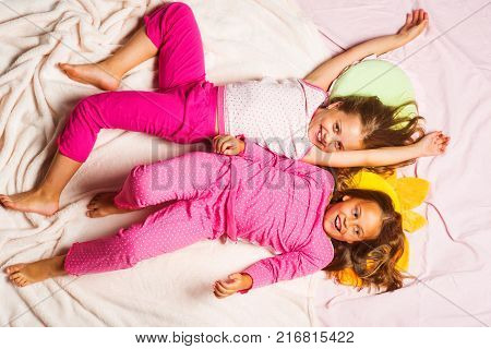 Kids Wearing Red Jammies Watch Tv Among Soft Toys