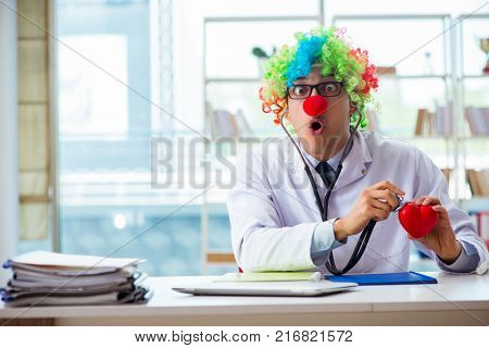 Child cardiologist with stethoscope and red heart